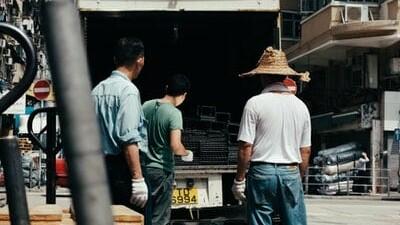 Men moving belongings