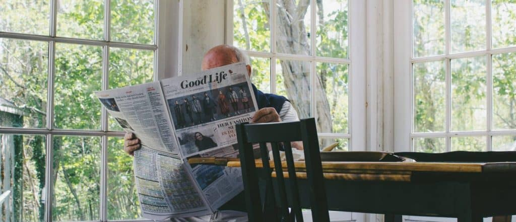 browsing newspaper